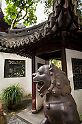 Iron lion statue guards the entry to Yu Yuan Gardens Shanghai, China