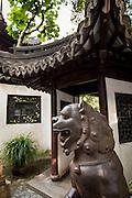 Iron lion statue guards the entry to Yu Yuan Gardens Shanghai, China