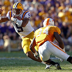 Oct 2, 2010; Baton Rouge, LA, USA; LSU Tigers quarterback Jordan Jefferson (9) runs away from Tennessee Volunteers linebacker Herman Lathers (34) during the second half at Tiger Stadium. LSU defeated Tennessee 16-14.  Mandatory Credit: Derick E. Hingle