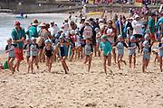 Manly beach. Weekend swimming test for children. Beach run.