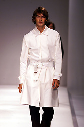 Jasper Conran Spring/Summer 2001 London Fashion Week.Male model, white shirt, unbuttoned, half length, black trousers, June 27, 2000..Photo by Andrew Parsons/i-Images.