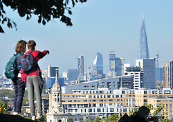 © Licensed to London News Pictures. 09/10/2018<br /> GREENWICH, UK.<br /> A view across London towards the Shard from Greenwich.<br /> People out and about in an autumnal Greenwich Park on a sunny October day in London and the South East with temperatures at 19C with blue sky. <br /> Photo credit: Grant Falvey/LNP