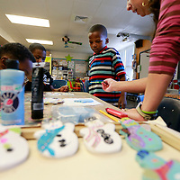 Thomas Wells   BUY AT PHOTOS.DJOURNAL.COM<br /> Thomas Street Elementray first grade student Bryson Shumpert, 7, gets ready to start painting his snowman Christmas tree ornament during his art class on Tuesday.