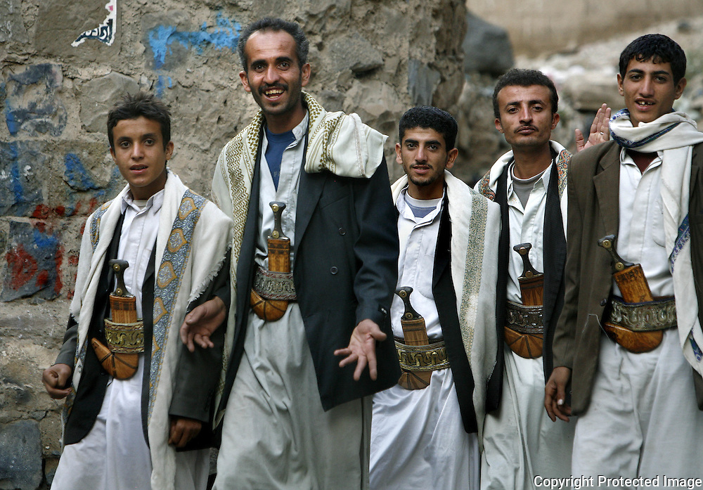 Yemeni men wearing the jambiyah, a traditional Yemeni sword, walk through the Old San'aa. UNESCO, the United Nations cultural organization, declared San'a a world heritage site in 1988. San'a was a trade capital as early as the 1st century B.C. With merchants crowded  inside the mud walls of the city, the San'anis built upwards -- as high as nine stories, an impressive feat given the technology of the time. San'aa's homes rest on lower stories built of stone; some date to the 9th or 10th centuries. Over generations, families added floors in brick, making each new floor slightly smaller than the previous one for stability.