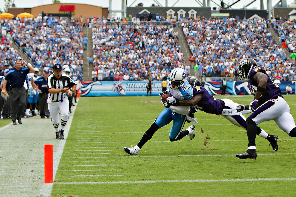 NASHVILLE, TN - SEPTEMBER 18:  Nate Washington #85 of the Tennessee Titans is tackled after a catch against the Baltimore Ravens at LP Field on September 18, 2011 in Nashville, Tennessee.  The Titans defeated the Ravens 26 to 13.   (Photo by Wesley Hitt/Getty Images) *** Local Caption *** Nate Washington