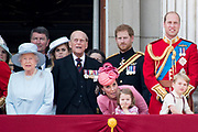Trooping the Colour is a ceremony performed by regiments of the British and Commonwealth armies and as also marked the official birthday of the British sovereign, Queen Elizabeth.It is held in London annually on a Saturday in June on Horse Guards Parade by St. James's Park<br /> <br /> On the photo:  Queen Elizabeth II and Prince Philip, Duke of Edinburgh<br /> Prince William, Catherine, Kate, Duchess of Cambridge and Prince George and Princess Charlotte , Prince Harry<br /> Prince Charles, Prince of Wales and Prince Harry