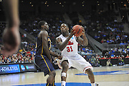 Ole Miss' Murphy Holloway (31) is fouled by La Salle's Taylor Dunn (5) in the Round of 32 of the NCAA Tournament at the Sprint Center in Kansas City, Mo. on Sunday, March 24, 2013.