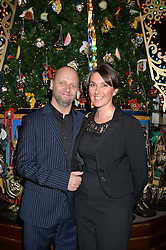 Claridge's  chef SIMON ROGAN and his wife PENNY at the Claridge's Christmas Tree By Dolce & Gabbana Launch Party held at Claridge's, Brook Street, London on 26th November 2013.