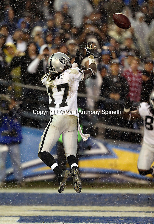 Oakland Raiders wide receiver Denarius Moore (17) leaps and catches a fourth quarter touchdown pass that cuts the San Diego Chargers lead to 24-21 during the NFL week 17 football game against the San Diego Chargers on Sunday, Dec. 30, 2012 in San Diego. The Chargers won the game 24-21. ©Paul Anthony Spinelli