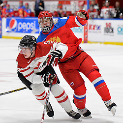 WHITBY, - Dec 14, 2015 -  Game #4 - Russia vs. Canada East at the 2015 World Junior A Challenge at the Iroquois Park Recreation Complex, ON. Quinn Wichers #8 of Team Canada East battles for position Mikhail Maltsev #11 of Team Russia during the first period.<br /> (Photo: Shawn Muir / OJHL Images)