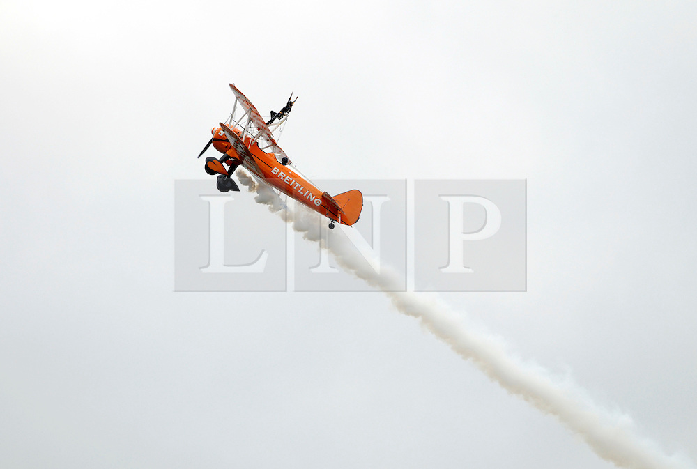 © Licensed to London News Pictures. 08/08/2014; Bristol, UK.  Brietling Wing Walker biplane display at the Bristol International Balloon Fiesta 2014, which is the largest such event in Europe.  Photo credit: Simon Chapman/LNP