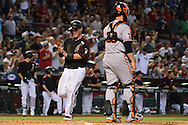 PHOENIX, AZ - MAY 14:  Chris Herrmann #10 of the Arizona Diamondbacks scores in the second inning in front of Buster Posey #28 of the San Francisco Giants at Chase Field on May 14, 2016 in Phoenix, Arizona.  (Photo by Jennifer Stewart/Getty Images)