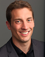 Corporate headshot of male worker at Zephus.