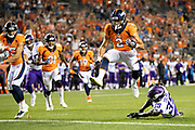 DENVER, CO - AUGUST 11:  Phillip Lindsay #2 of the Denver Broncos jumps into the end zone for a touchdown during preseason week 1 against the Minnesota Vikings at Broncos Stadium at Mile High on August 11, 2018 in Denver, Colorado.  The Vikings defeated the Broncos 42-28.  (Photo by Wesley Hitt/Getty Images) *** Local Caption *** Phillip Lindsay
