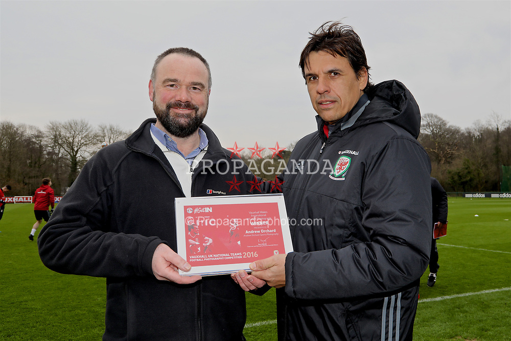 CARDIFF, WALES - Thursday, March 23, 2017: Wales' manager Chris Coleman presents the award for Vauxhall Inspirational Photograph of the Year to Andrew Orchard before a training session at the Vale Resort ahead of the 2018 FIFA World Cup Qualifying Group D match against Republic of Ireland. (Pic by David Rawcliffe/Propaganda)