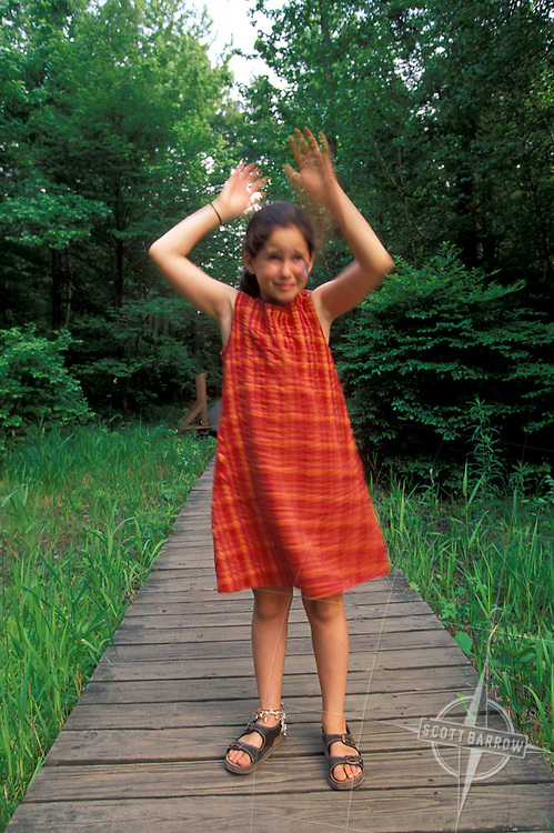 Girl swatting insects