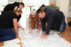 © Licensed to London News Pictures 24/10/2018<br /> New Ash Green,UK.<br /> Local volunteers based at The Pavilion checking a large map for search locations. <br /> The search for missing mother Sarah Wellgreen continues.<br /> Sarah has been missing for over two weeks and was last seen on the evening of October 9th.<br /> Photo credit: Grant Falvey/LNP