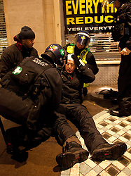 © under license to London News Pictures. 30/11/2010: Students  in London continue to protest against cutbacks and the coalition government's proposed rise in tuition fees. Objects were thrown. This man was hit by a metal bar