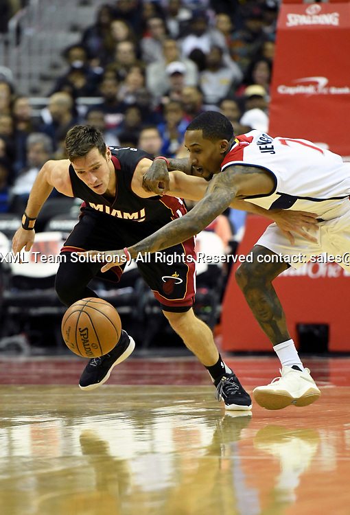 WASHINGTON, DC - APRIL 8: Miami Heat guard Goran Dragic (7) fights for a turnover in the first half with Washington Wizards guard Brandon Jennings (7) on April 8, 2017, at the Verizon Center in Washington, D.C.  The Miami Heat defeated the Washington Wizards 106-103.  (Photo by Icon Sportswire)