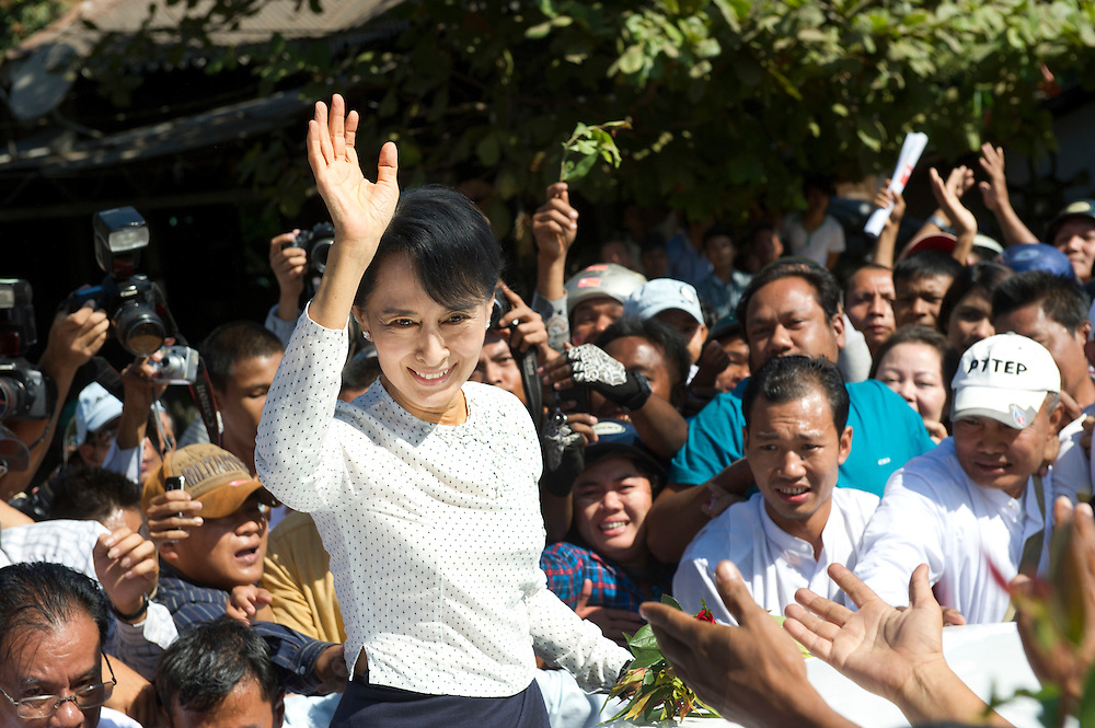 The National League of Democracy (NLD) head, Pro-democracy leader Aung San Suu Kyi is mobbed by supporters during an impromptu walk around after registering to run in a by-election, for the  parliamentary seat in Kawhmu, in polls on April 1st, 2012. Thanlynn Electoral Commission Office, January 18, 2012....