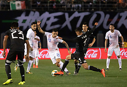 March 22, 2019 - Charles Aranguiz (20) of Chile and Edson Alvarez (4) of Mexico fight for possession of the ball during Mexico's 3-1 victory over Chile. (Credit Image: © Rishi Deka/ZUMA Wire)