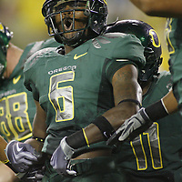 Oregon's Walter Thurmond III celebrates after returning an interception for a touchdown in the second quarter of the Ducks non-conference game against Purdue, in Autzen Stadium, on Saturday, Sept. 12, 2009.