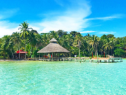 EXCLUSIVE: How about owning your own tropical Caribbean luxury resort for just $10. American couple Suzanne and Dave Smith are selling off their incredible Casa Cayuco Eco Adventure Lodge, in Bocas del Toro, Panama, Central America. But instead of listing their stunning multi-million-pound island getaway for sale they are offering the chance for anyone who buys a $10 ticket to win their extraordinary lifestyle and profitable business. Dave and Suzanne have spent five years turning a former rustic lodge into one that has just been voted number one resort on TripAdvisor in Panama. Their incredible two-acre slice of heaven is bordered by sloth-filled rainforest to the rear and crystal clear coral sea to the front. The lucky winner of the 24-guest resort will become owner of four stand-alone cabins, a main lodge, two lodge suites, and an air-conditioned luxury owner's suite designed by Dave and Suzanne themselves and built by skilled local carpenters. Outside, Casa Cayuco comes with its own jetty and thatch covered sun terrace as well as everything you need to run a business, including commercial kitchen communication tower, laundry and maintenance building and THREE power boats, each over 23-foot long. Kayaks, snorkelling, spear fishing and paddle boards and surf gear are also ready and waiting to be used by a new owner and guests alike. And if that's not enough, British competition organisers WinThis.Life https://winthis.life/index.aspx# are offering a $50,000 cash injection to welcome the new owners. All those wishing to take part have to do is buy one or more tickets and play a spot-the-ball-type competition on the website. Entries are being taken extension until April 11. Dave, 35, and Suzanne, 33, first arrived on the island in 2013 with just seven suitcases having decided to sell up from their home and corporate lives near Detroit, Michigan, USA. 16 Feb 2018 Pictured: Pic shows stunning Caribbean resort Casa Cayuco in Panama which one lucky winner could own.