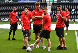 """Southampton's Josh Sims (left), Sam Gallagher, Harrison Reed (second right) and Sam McQueen (right) before a pre season friendly match at Pride Park, Derby. PRESS ASSOCIATION Photo. Picture date: Saturday July 21, 2018. Photo credit should read: Anthony Devlin/PA Wire. EDITORIAL USE ONLY No use with unauthorised audio, video, data, fixture lists, club/league logos or """"live"""" services. Online in-match use limited to 75 images, no video emulation. No use in betting, games or single club/league/player publications."""