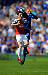 CARDIFF, WALES - Sunday, September 2, 2018: Arsenal's Mesut Özil and Cardiff City's Sol Bamba during the FA Premier League match between Cardiff City FC and Arsenal FC at the Cardiff City Stadium. (Pic by David Rawcliffe/Propaganda)