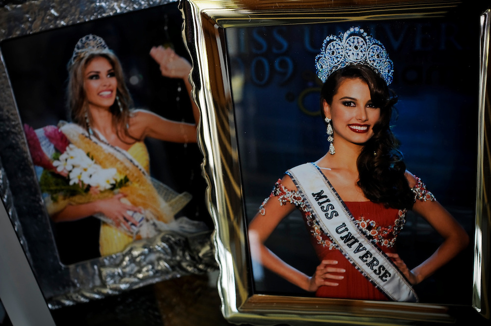 (L) Dayana Mendoza and (R) Stefania Fernandez helped Venezuela set a record by winning the Miss Universe crown in two consecutive years, 2008 and 2009, respectively.  Their photos are displayed at La Quinta Miss Venezuela school in Caracas, Venezuela.