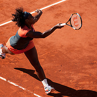 30 May 2009: Serena Williams of USA stretches for a forehand during the Women's Third Round match on day seven of the French Open at Roland Garros in Paris, France.