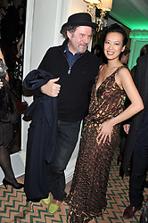 MIKE FIGGIS and ROSIE CHAN at the unveiling of the Claridge's Christmas tree 2011 designed by Alber Elbaz for Lanvin held at Claridge's, Brook Street, London on 5th December 2011.