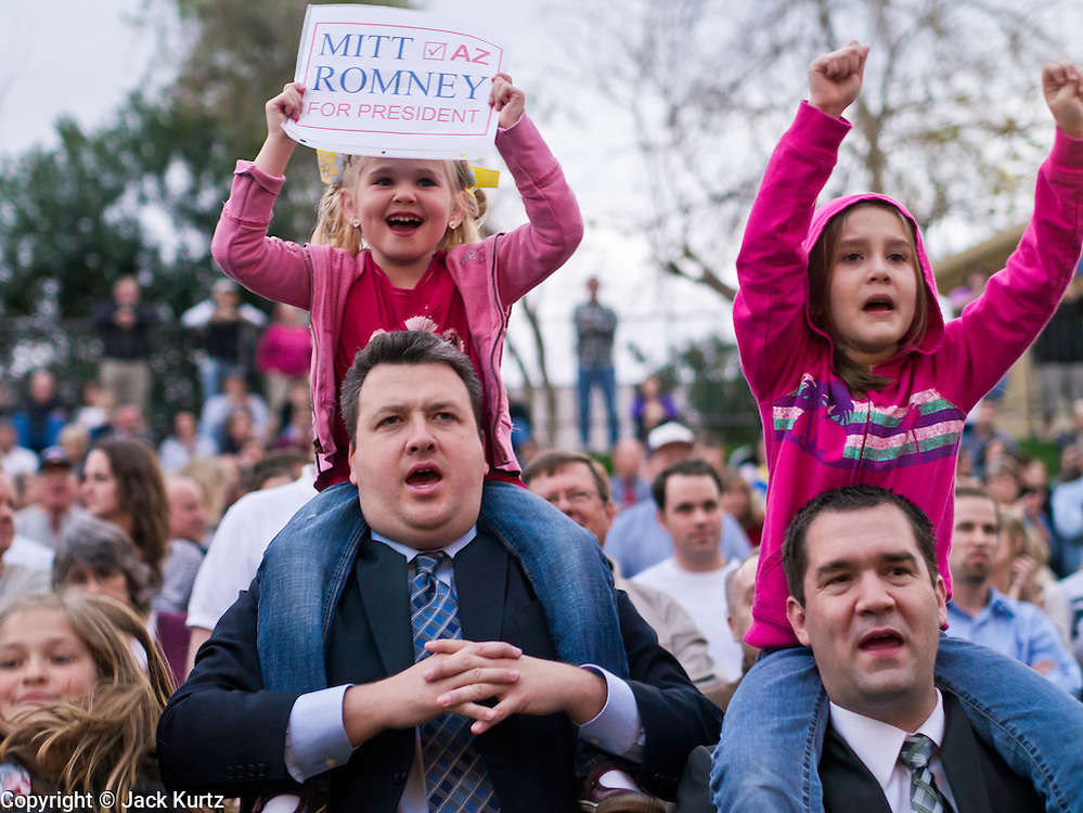 13 FEBRUARY 2012 - MESA, AZ:   Mitt Romney supporters wait for Romney to arrive at the Mesa Amphitheatre. Several thousand people crowded into the amphitheatre in Mesa, AZ, Monday night to hear Republican Presidential candidate Mitt Romney speak. Romney, a Mormon, is expected to win in Arizona, which has a large Mormon population. Arizona's Republican Presidential primary is February 28.      PHOTO BY JACK KURTZ