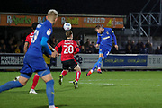 AFC Wimbledon attacker Shane McLoughlin (19) heading the ball during the EFL Sky Bet League 1 match between AFC Wimbledon and Lincoln City at the Cherry Red Records Stadium, Kingston, England on 2 November 2019.