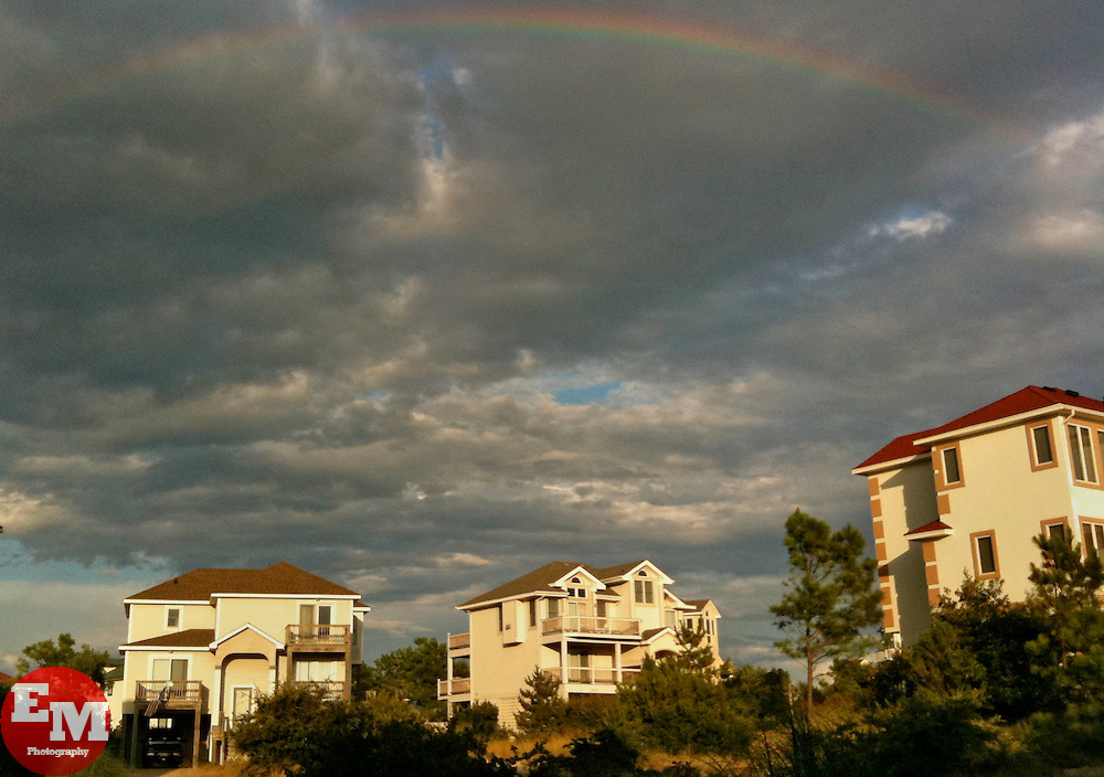 August 2009; A rainbow forms above the town of Corolla, NC after a storm.