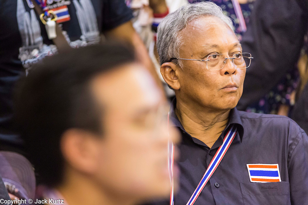 SUTHEP THAUGSUBAN, leader of the anti-government protests rocking Bangkok, at a press conference in the Ministry of Finance building. The Thai government issued as warrant for Suthep as the protests spread but he has not been arrested. Protestors opposed to the government of Thai Prime Minister Yingluck Shinawatra spread out through Bangkok this week. Protestors have taken over the Ministry of Finance, Ministry of Sports and Tourism, Ministry of the Interior and other smaller ministries. The protestors are demanding the Prime Minister resign, the Prime Minister said she will not step down. This is the worst political turmoil in Thailand since 2010 when 90 civilians were killed in an army crackdown against Red Shirt protestors. The Pheu Thai party, supported by the Red Shirts, won the 2011 election and now govern. The protestors demanding the Prime Minister step down are related to the Yellow Shirt protestors that closed airports in Thailand in 2008.