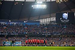 MANCHESTER, ENGLAND - Saturday, April 7, 2018: Manchester City and Manchester United players stand for a moment's applause to remember the late Ray Wilkins during the FA Premier League match between Manchester City FC and Manchester United FC at the City of Manchester Stadium. (Pic by David Rawcliffe/Propaganda)