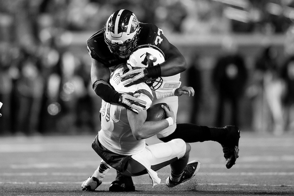 Nov 7, 2015; Ann Arbor, MI, USA; Michigan Wolverines defensive end Taco Charlton (33) sacks Rutgers Scarlet Knights quarterback Hayden Rettig (11) in the fourth quarter at Michigan Stadium. Michigan won 46-16. Mandatory Credit: Rick Osentoski-USA TODAY Sports