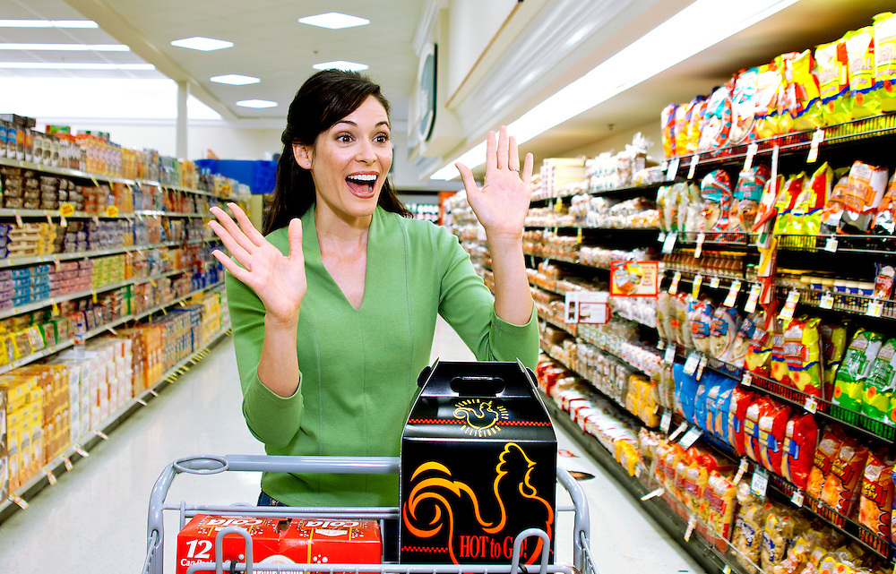 An excited female shopper in the grocery store