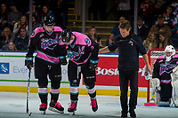 KELOWNA, CANADA - OCTOBER 21: Athletic Therapist Scott Hoyer and Gordie Ballhorn #4 assist James Hilsendager #2 of the Kelowna Rockets off the ice against the Portland Winterhawks on October 21, 2017 at Prospera Place in Kelowna, British Columbia, Canada.  (Photo by Marissa Baecker/Shoot the Breeze)  *** Local Caption ***