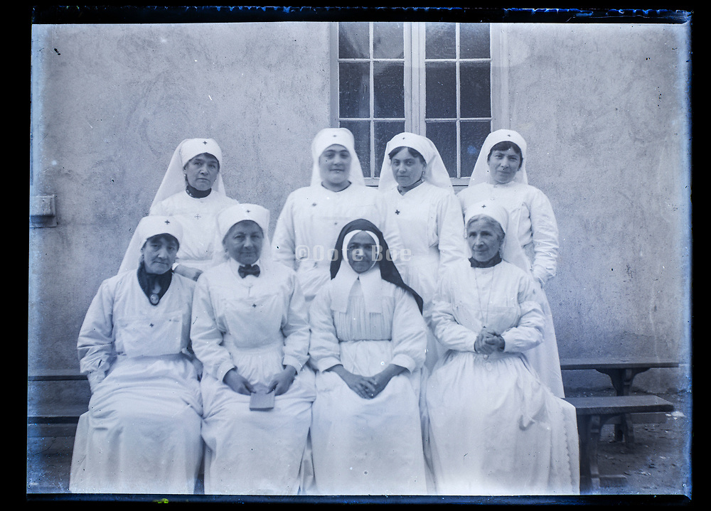 group portrait of nun with nurses France ca 1920s