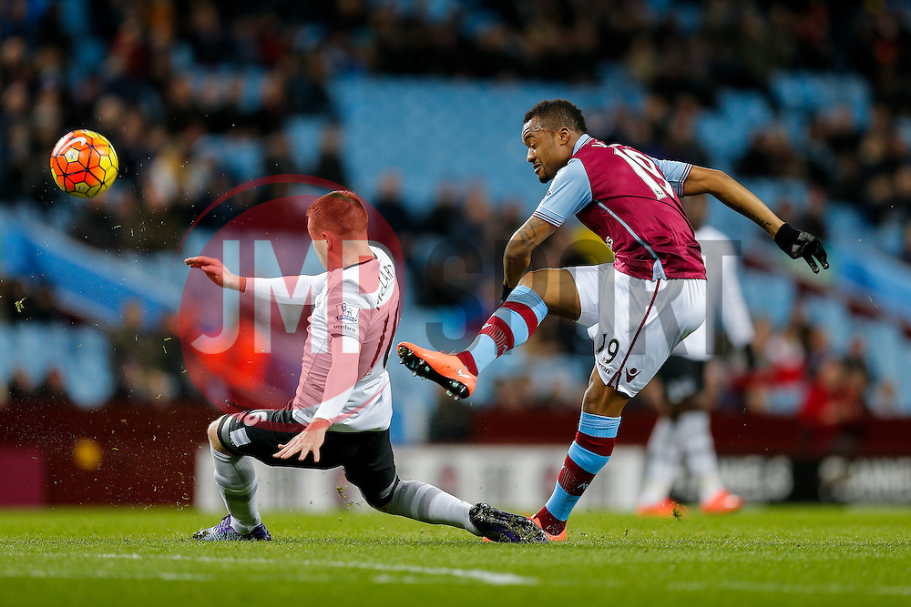 Jordan Ayew of Aston Villa shoots past James McCarthy of Everton - Mandatory byline: Rogan Thomson/JMP - 01/03/2016 - FOOTBALL - Villa Park Stadium - Birmingham, England - Aston Villa v Everton - Barclays Premier League.