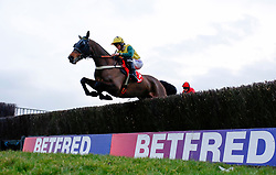 Milansbar ridden by Bryony Frost clear an early fence on the way to winning The Betfred Classic Handicap Steeple Chase Race run during Betfred Classic Chase Day at Warwick racecourse, Warwick.