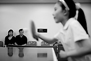 Parents watch as their daughter takes a weekend table tennis lesson in a sports center in Beijing.