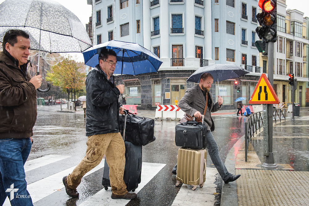Church member Jose Antonio (left) walks to the train station with the Rev. David Warner and the Rev. Adam Lehman, LCMS career missionaries to Spain, following fellowship and an evening home worship, on Saturday morning, Nov. 5, 2016, in Valladolid, Spain. LCMS Communications/Erik M. Lunsford