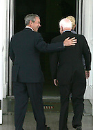 President George W. Bush Greets Republican presidential nominee Senator John McCain and Mrs. McCain at the North Portico of the White House on March 5, 2008.  Photograph by Dennis Brack