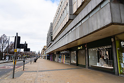 Edinburgh, Scotland, UK. 29 March, 2020. Life in Edinburgh on the first Sunday of the Coronavirus lockdown. Streets deserted, shops and restaurants closed, very little traffic on streets and reduced public transport. Pictured; Princes Street is deserted of shoppers. Iain Masterton/Alamy Live News