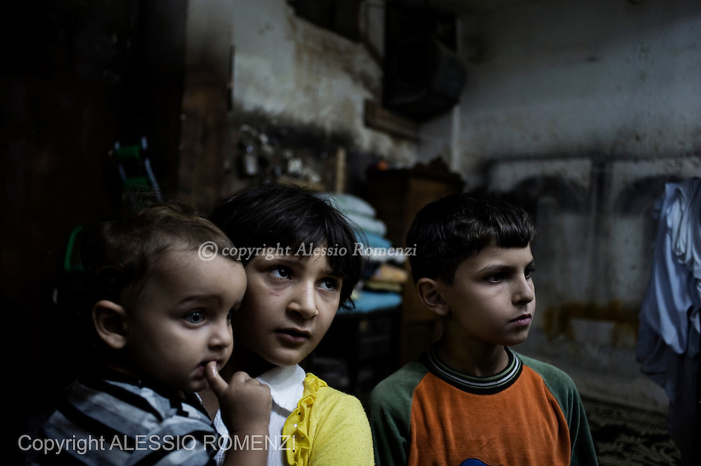 SYRIA, ALEPPO. Family living in basements after their houses have been destroyed by regime shelling on September 28, 2012. ALESSIO ROMENZI