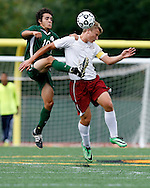 Kevin Bartram | Staff<br /> New Britain's Kuba Kazmierczak, right, and Maloney's Ricardo Lopez battle for the ball during a game between Maloney and New Britain on Tuesday at Veterans Memorial Stadium in New Britain.