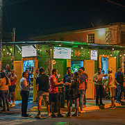 SAN JUAN, PUERTO RICO -- JANUARY 31, 2019: <br /> Bar patrons start to enjoy the early evening outside the Bar Esquina Watusi, a very popular dive bar in the Santurce area of San Juan. It's a crowd favorite.<br /> (Photo by Angel Valentin)